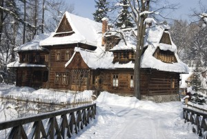 Zakopane, Koliba villa - traditional highland log house in the snow
